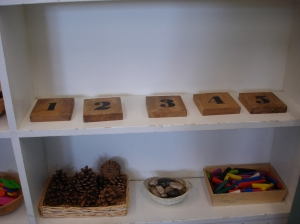 Natural materials appear in the math centre too. The numbered blocks are coasters I found at Winners!