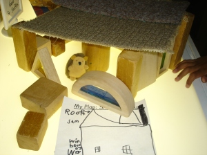 """""""Inside Snuffles house are so many toys. I used the square blocks with the colours because you can see through them. They are windows."""""""