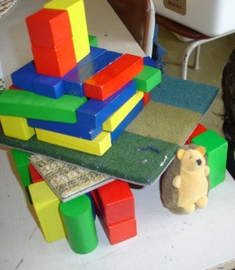 """First I made a square and I thought I could use blocks for the roof but it was too small for Snuffles so I made it so he can fit. It has 2 chimneys and a 2nd floor where he sleeps."""