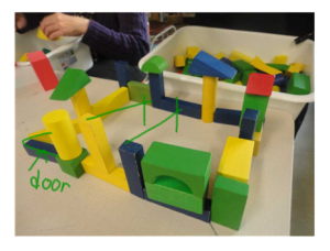 A photo showing a student who struggled with adding a roof to her structure.