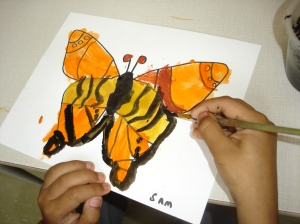 Representing our butterflies with beautiful watercolour paintings. The children worked very hard to create symmetrical designs on the butterfly wings.