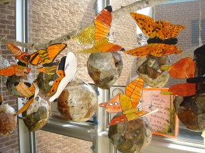 Our butterflies were clipped to our chrysalises and hung from a branch suspended from the ceiling.
