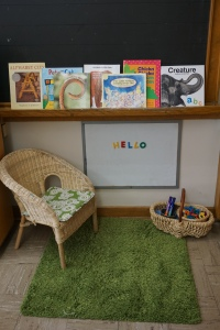 """""""Teacher Centre""""  A quiet place to re-enact classroom routines, read books, and play with literacy materials."""