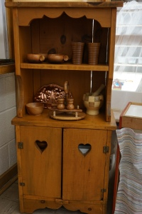 A closer look at the kitchen hutch filled with lovely wooden items from the thrift store.